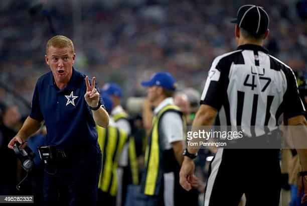 Head coach Jason Garrett of the Dallas Cowboys signals to line judge Tim Podraza against the Seattle Seahawks in the second quarter at ATT Stadium on...