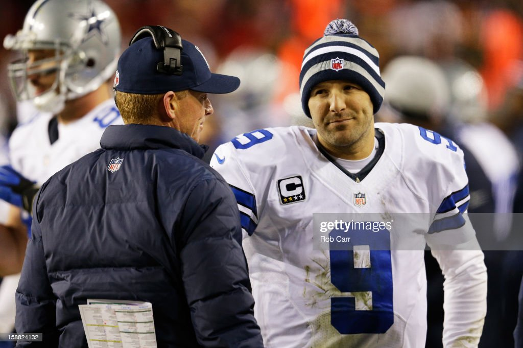 Head coach Jason Garrett talks to Tony Romo #9 of the Dallas Cowboys after they failed to convert on a third down against the Washington Redskins at FedExField on December 30, 2012 in Landover, Maryland.