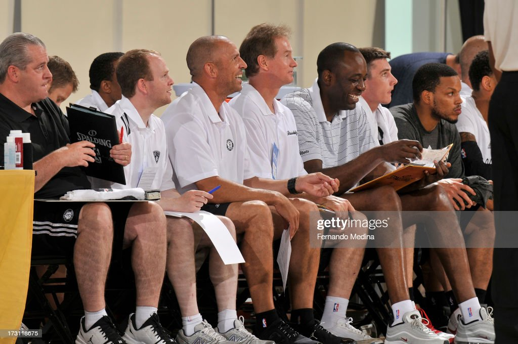 Head Coach Jason Kidd and Assistant Coach Lawrence Frank of the Brooklyn Nets watch from the bench during the 2013 Southwest Airlines Orlando Pro...
