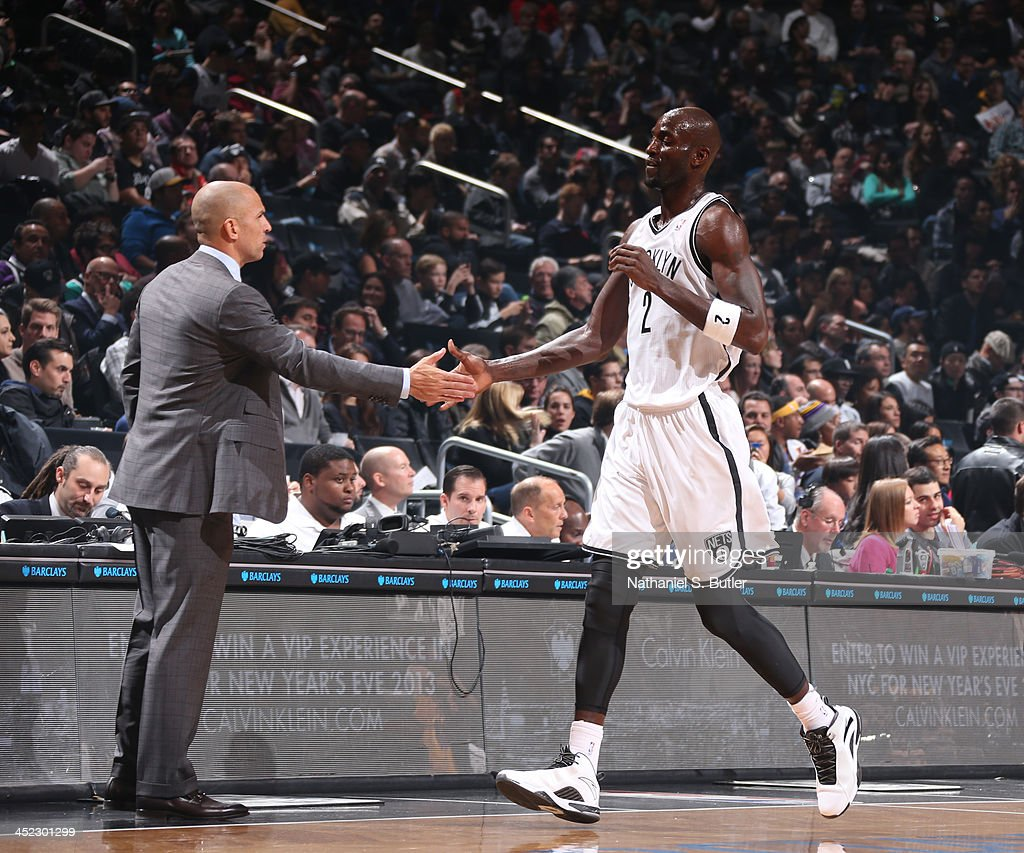 Head Coach Jason Kidd of the Brooklyn Nets high fives player Kevin Garnett #2 of the Brooklyn Nets during a game against the Los Angeles Lakers at Barclays Center on November 27, 2013 in the Brooklyn borough of New York City.