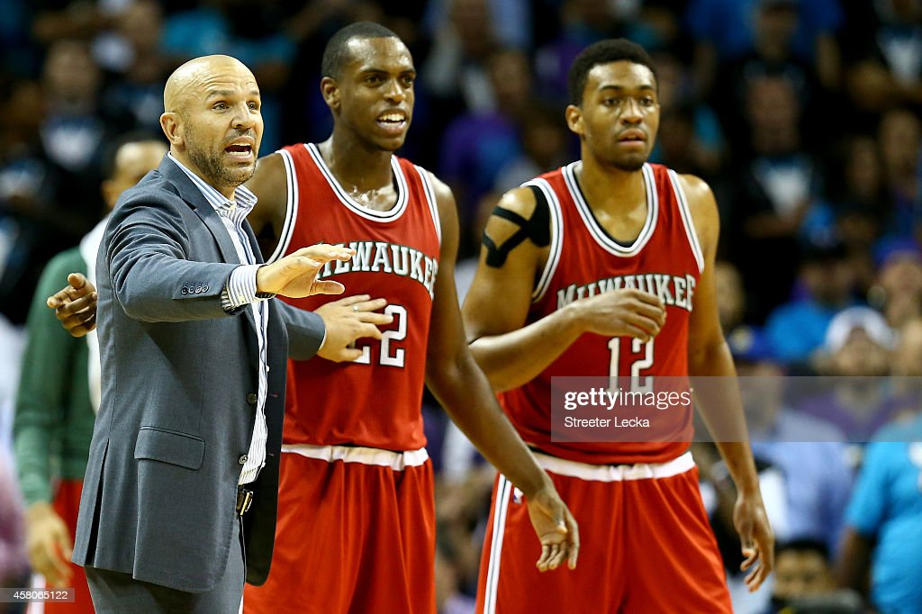Head coach Jason Kidd of the Milwaukee Bucks reacts with his players Khris Middleton #22 and Jabari Parker #12 of the Milwaukee Bucks during their game against the Charlotte Hornets at Time Warner Cable Arena on October 29, 2014 in Charlotte, North Carolina. The Charlotte Hornets defeated the Milwaukee Bucks 108-106 in overtime.