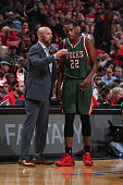 Head Coach Jason Kidd of the Milwaukee Bucks talks with Khris Middleton against the Chicago Bulls in Game Two of the Eastern Conference Quarterfinals...