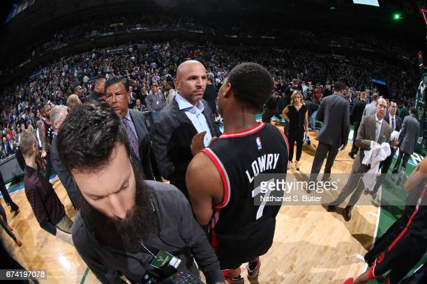 Head Coach Jason Kidd of the Milwaukee Bucks talks with Kyle Lowry of the Toronto Raptors after Game Six of the Eastern Conference Quarterfinals of...