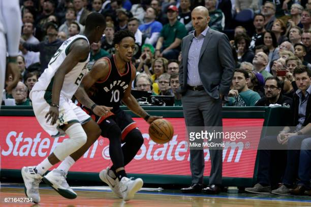 Head Coach Jason Kidd of the Milwaukee Bucks watch DeMar DeRozan of the Toronto Raptors dribble up the court during the second half of Game Four of...