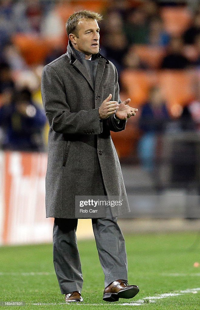 Head coach <a gi-track='captionPersonalityLinkClicked' href=/galleries/search?phrase=Jason+Kreis&family=editorial&specificpeople=767031 ng-click='$event.stopPropagation()'>Jason Kreis</a> of the Real Salt Lake applauds his team from the sideline during the first half against the D.C. United at RFK Stadium on March 9, 2013 in Washington, DC.