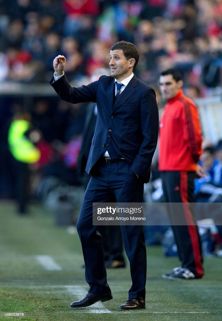 Head coach Javier Garcia of CA Osasuna gives instructions during the La Liga match between CA Osasuna and Real Madrid CF at Estadio El Sadar de Navarra on December 14, 2013 in Pamplona, Spain.