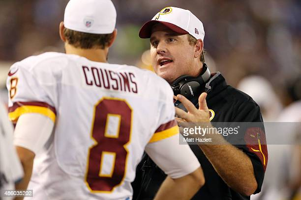 Head coach Jay Gruden of the Washington Redskins talks with quarterback Kirk Cousins of the Washington Redskins in the fourth quarter of a preseason...
