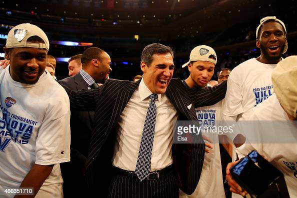 Head coach Jay Wright of the Villanova Wildcats celebrates with his players after defeating the Xavier Musketeers 6952 in the championship game of...