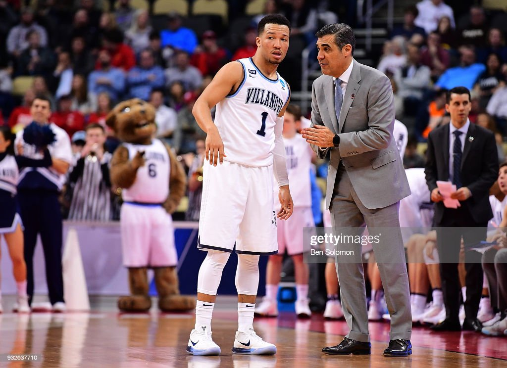 head coach Jay Wright of the Villanova Wildcats talks to Jalen Brunson #1 in the first half during the first round of the 2018 NCAA Men's Basketball Tournament held at PPG Paints Arena on March 15, 2018 in Pittsburgh, Pennsylvania.