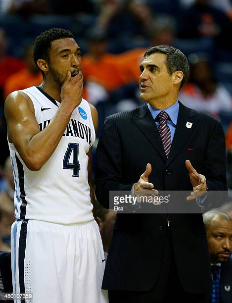 Head coach Jay Wright speaks with Darrun Hilliard II of the Villanova Wildcats during the third round of the 2014 NCAA Men's Basketball Tournament...