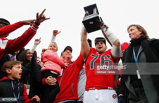 Head coach Jeff Brohm and Forrest Lamp of the Western Kentucky Hilltoppers celebrate following the game against the Louisiana Tech Bulldogs at...