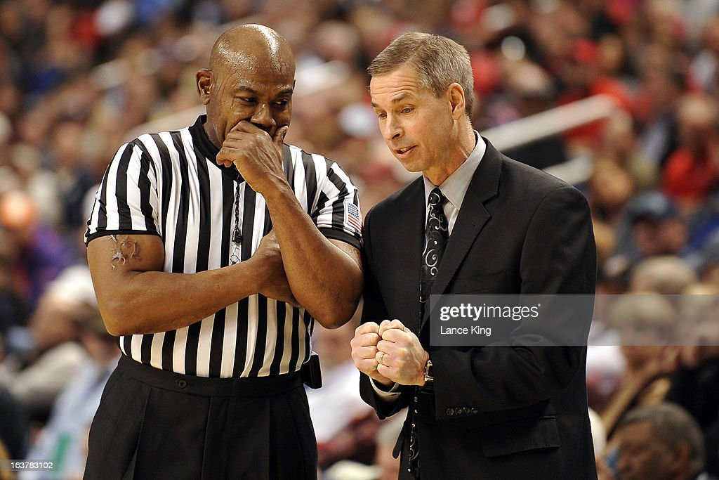 Head Coach Jeff Bzdelik (R) of the Wake Forest Demon Deacons talks with referee Les Jones during a game against the Maryland Terrapins during the first round of the 2013 Men's ACC Tournament at the Greensboro Coliseum on March 14, 2013 in Greensboro, North Carolina. Maryland defeated Wake Forest 75-62.