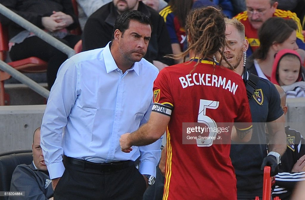 Head coach Jeff Cassar (L) talks with his player Kyle Beckerman #5 of Real Salt Lake in the first half of their 2-1 win over Seattle Sounders FC at Rio Tinto Stadium on March 12, 2016 in Sandy, Utah.