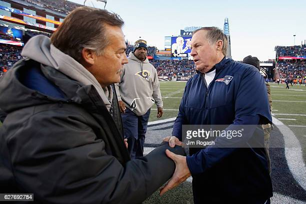 Head coach Jeff Fisher of the Los Angeles Rams shakes hands with head coach Bill Belichick of the New England Patriots after the Patriots defeated...