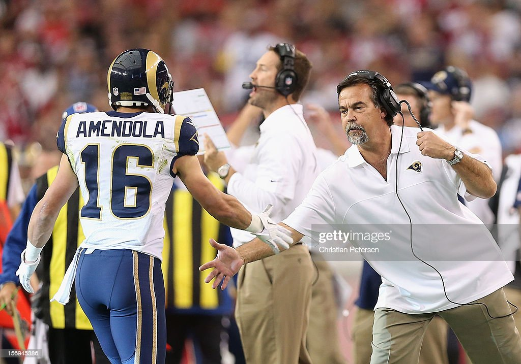 Head coach Jeff Fisher of the St. Louis Rams high-fives wide receiver Danny Amendola #16 after he caught a 38 yard reception against the Arizona Cardinals during the second quarter of the NFL game at the University of Phoenix Stadium on November 25, 2012 in Glendale, Arizona.