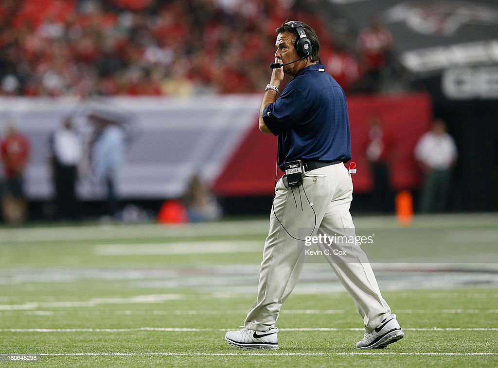 Head coach Jeff Fisher of the St. Louis Rams reacts during a timeout against the St. Louis Rams at Georgia Dome on September 15, 2013 in Atlanta, Georgia.