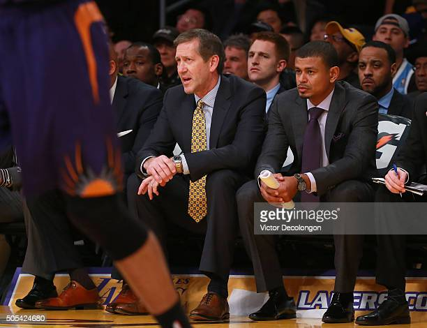 Head Coach Jeff Hornacek and assistant coach Earl Watson of the Phoenix Suns look on from the bench during the NBA game between and the Phoenix Suns...