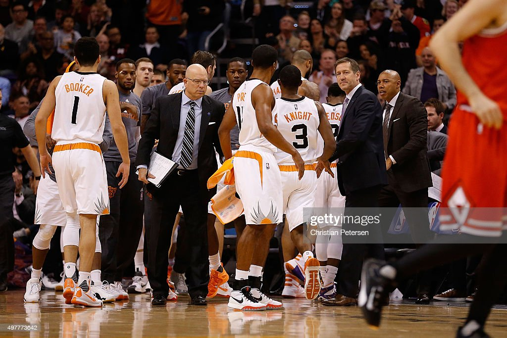 Head coach Jeff Hornacek of the Phoenix Suns highfives his team as they break for a time out during the NBA game against the Chicago Bulls at Talking...