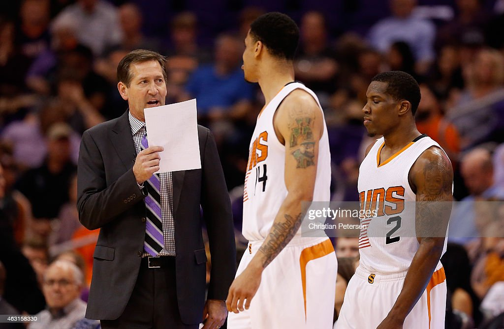 Head coach Jeff Hornacek of the Phoenix Suns talks with Gerald Green and Eric Bledsoe during a break from the NBA game against the Houston Rockets at...