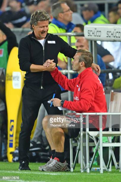 Head coach Jeff Saibene and assistant coach Carsten Rump celebrate during the Second Bundesliga match between DSC Arminia Bielefeld and VfL Bochum...
