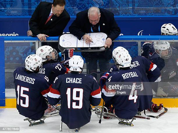 Head Coach Jeff Sauer gives instructions to his players during the Ice Sledge Hockey Preliminary Round Group B match between USA and Russia at the...