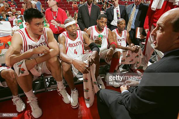 Head coach Jeff Van Gundy of the Houston Rockets talks to players Yao Ming Stromile Swift Tracy McGrady and Rafer Alston of the Rockets during a time...