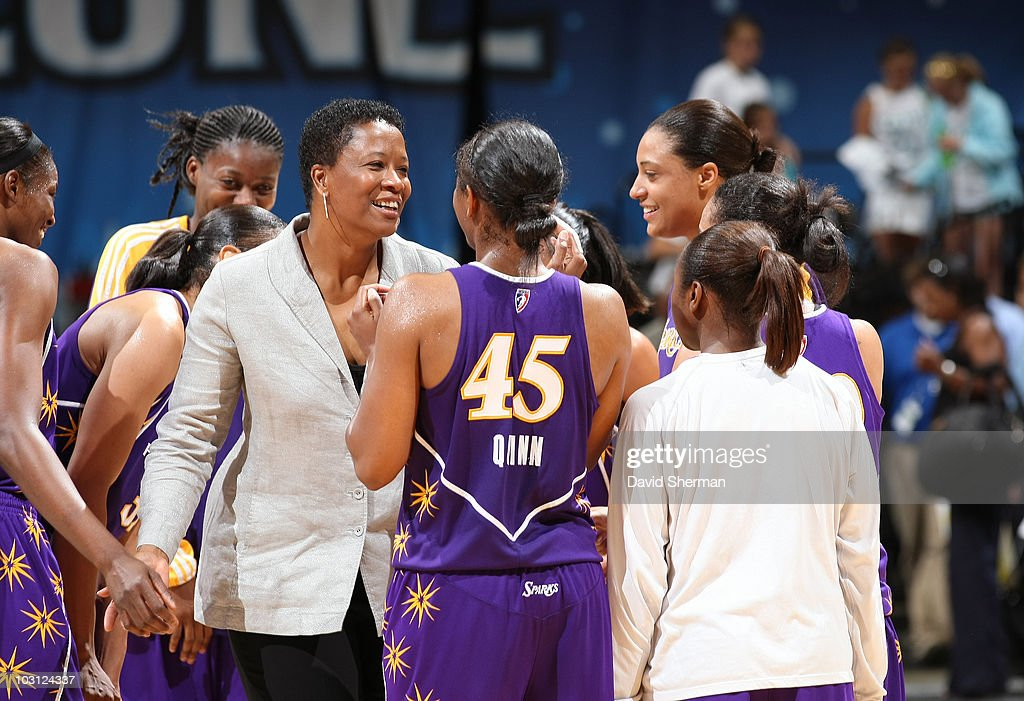 Head coach Jennifer Gillom of the Los Angeles Sparks celebrates with her players the victory over her former team the Minnesota Lynx on July 27, 2010 at the Target Center in Minneapolis, Minnesota.