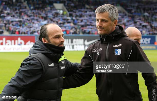 Head coach Jens Haertel of Magdeburg and head coach Christian Brand of Rostock look on prior to the third league match between FC Hansa Rostock and...