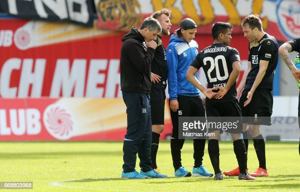 Head coach Jens Haertel of Magdeburg and his players show their frustration after the third league match between FC Hansa Rostock and 1FC Magdeburg...