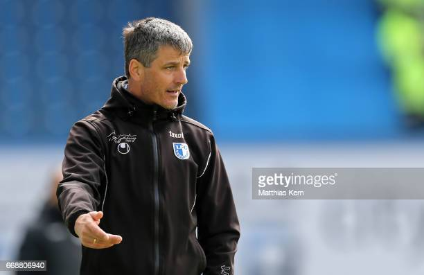 Head coach Jens Haertel of Magdeburg gestures during the third league match between FC Hansa Rostock and 1FC Magdeburg at Ostseestadion on April 15...