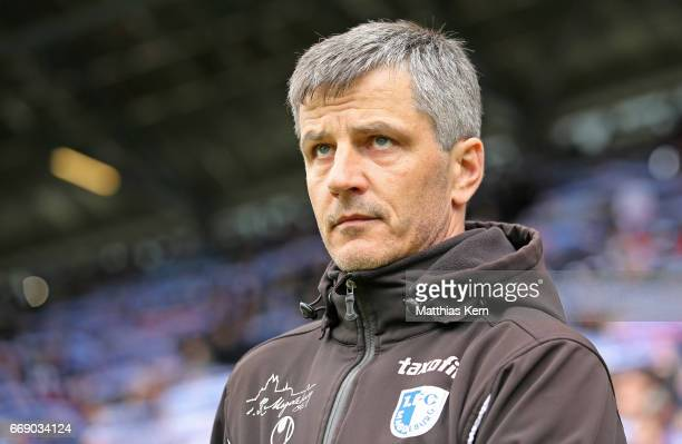 Head coach Jens Haertel of Magdeburg looks on prior to the third league match between FC Hansa Rostock and 1FC Magdeburg at Ostseestadion on April 15...