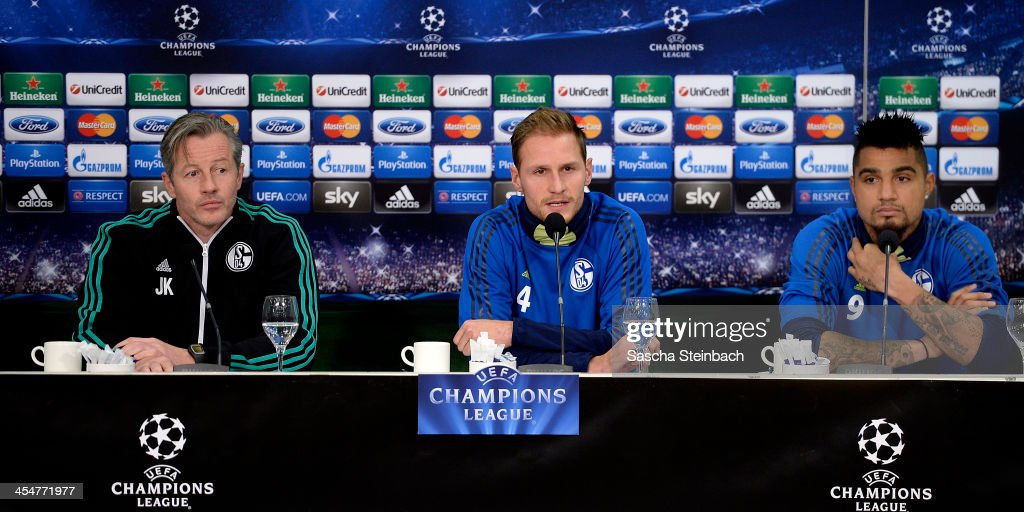 Head coach <a gi-track='captionPersonalityLinkClicked' href=/galleries/search?phrase=Jens+Keller&family=editorial&specificpeople=2382918 ng-click='$event.stopPropagation()'>Jens Keller</a>, Benedikt Hoewedes and <a gi-track='captionPersonalityLinkClicked' href=/galleries/search?phrase=Kevin-Prince+Boateng&family=editorial&specificpeople=613049 ng-click='$event.stopPropagation()'>Kevin-Prince Boateng</a> of FC Schalke 04 attend a press conference prior to their UEFA Champions League Group E match against FC Basel at Veltins-Arena on December 10, 2013 in Gelsenkirchen, Germany.