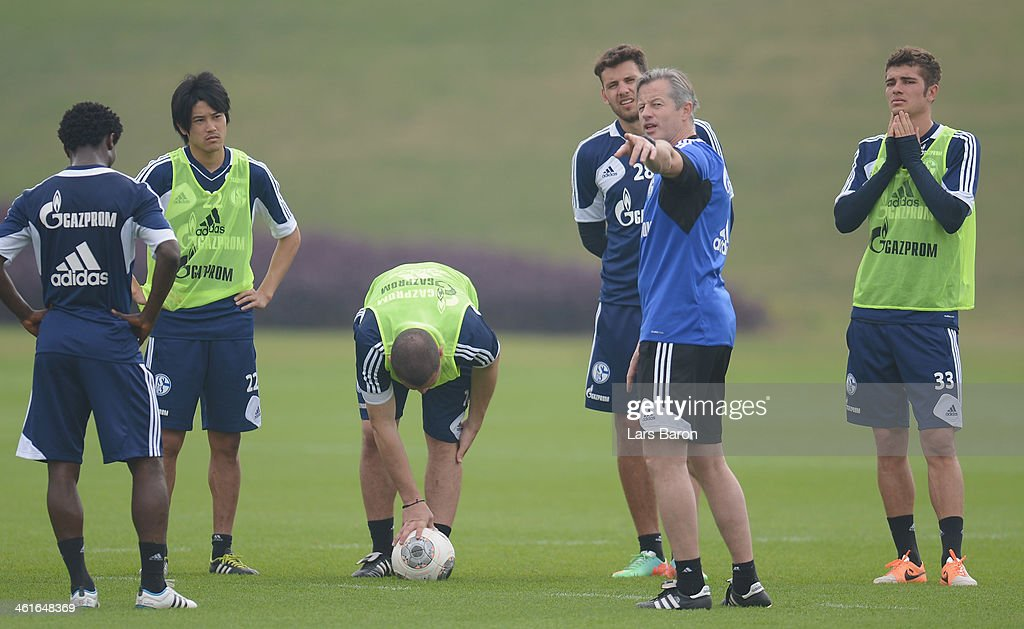 Head coach <a gi-track='captionPersonalityLinkClicked' href=/galleries/search?phrase=Jens+Keller&family=editorial&specificpeople=2382918 ng-click='$event.stopPropagation()'>Jens Keller</a> gives instructions during a FC Schalke 04 training session at ASPIRE Academy for Sports Excellence on January 10, 2014 in Doha, Qatar.