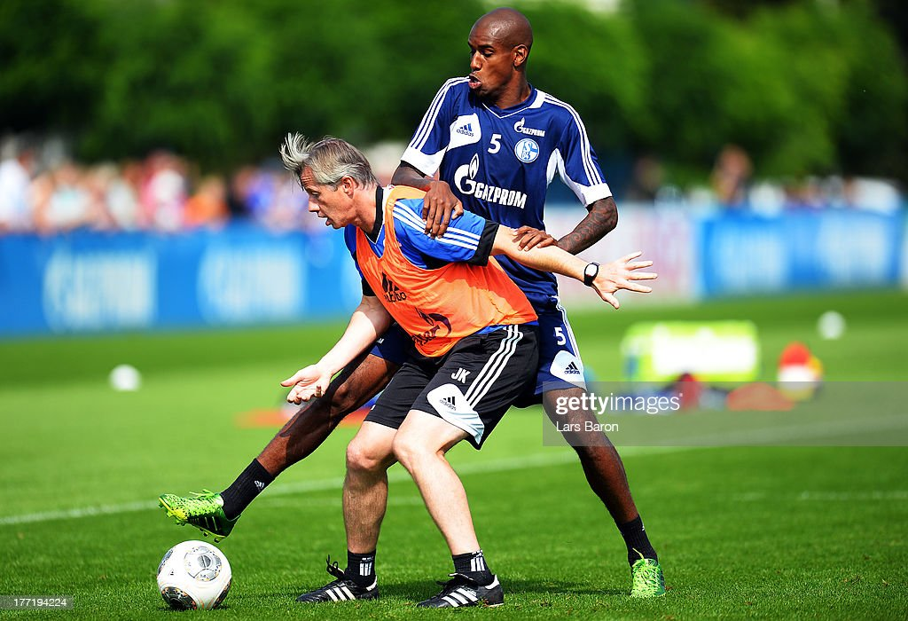 Head coach <a gi-track='captionPersonalityLinkClicked' href=/galleries/search?phrase=Jens+Keller&family=editorial&specificpeople=2382918 ng-click='$event.stopPropagation()'>Jens Keller</a> is challenged by Felipe Santana during a FC Schalke 04 training session on August 22, 2013 in Gelsenkirchen, Germany.