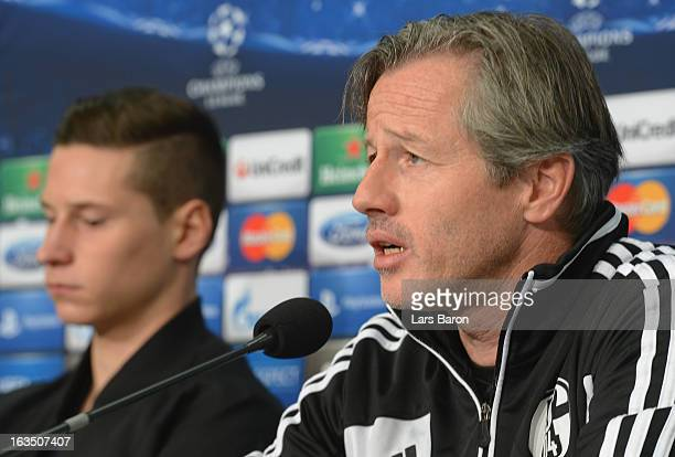 Head coach Jens Keller is seen next to Julian Draxler during a FC Schalke 04 press conference ahead of their UEFA Champions League round of 16 match...