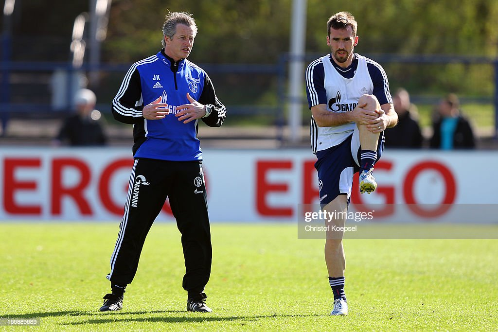 Head coach Jens Keller issues instructions to Christian Fuchs during the FC Schalke 04 training session at their training ground on April 18, 2013 in Gelsenkirchen, Germany.