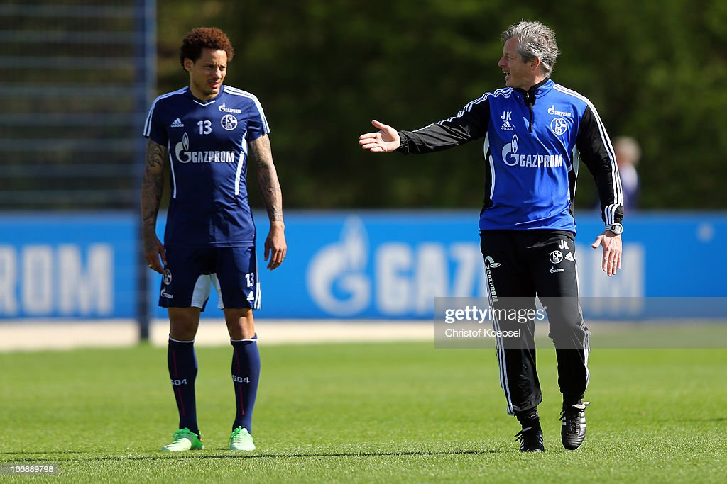Head coach Jens Keller issues instructions to Jermaine Jones (L) during the FC Schalke 04 training session at their training ground on April 18, 2013 in Gelsenkirchen, Germany.