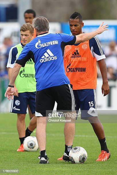 Head coach Jens Keller issues instructions to Max Meyer and Dennis Aogo during the training session of Schalke 04 at training ground on August 29...