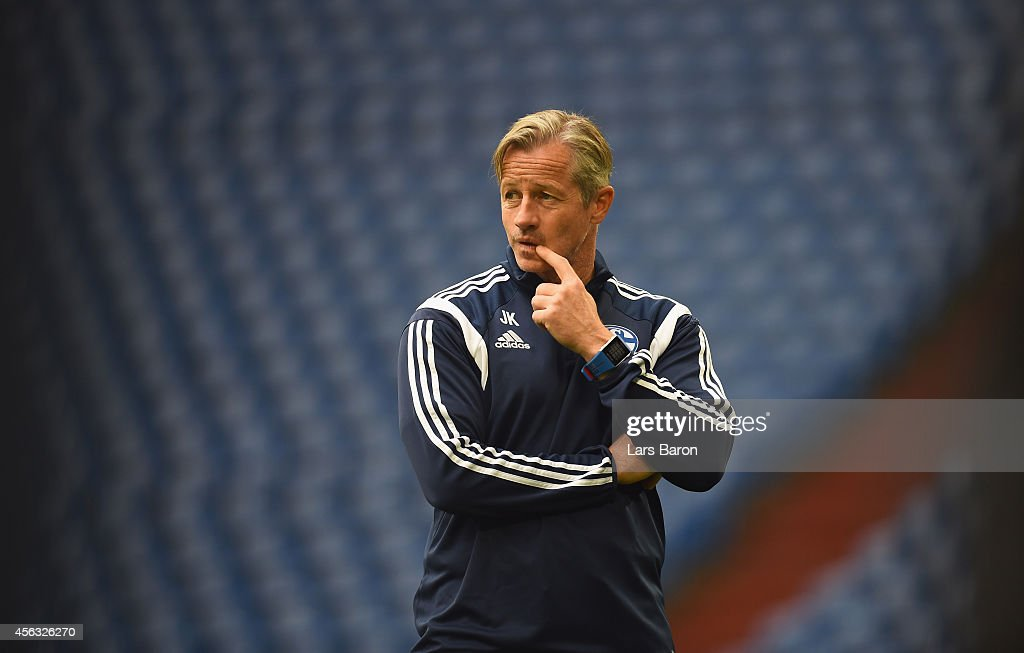 Head coach <a gi-track='captionPersonalityLinkClicked' href=/galleries/search?phrase=Jens+Keller&family=editorial&specificpeople=2382918 ng-click='$event.stopPropagation()'>Jens Keller</a> looks on during a FC Schalke 04 training session prior to their UEFA Champions League match against NK Maribor at Veltins Arena on September 29, 2014 in Gelsenkirchen, Germany.