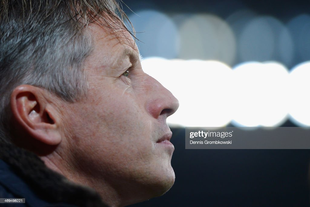 Head coach Jens Keller of FC Schalke 04 reacts prior to the Bundesliga match between Bayer Leverkusen and FC Schalke 04 at BayArena on February 15, 2014 in Leverkusen, Germany.