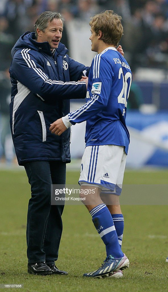 Head coach <a gi-track='captionPersonalityLinkClicked' href=/galleries/search?phrase=Jens+Keller&family=editorial&specificpeople=2382918 ng-click='$event.stopPropagation()'>Jens Keller</a> of Schalke and Teemu Pukki of Schalke celebrate after winning 3-0 the Bundesliga match between FC Schalke 04 and TSG 1899 Hoffenheim at Veltins-Arena on March 30, 2013 in Gelsenkirchen, Germany.