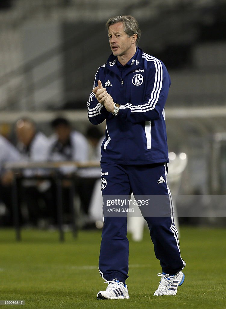 Head coach Jens Keller of Schalke applauds during the friendly match between Al-Sadd Sports Club and FC Schalke 04 in Doha, on January 6, 2013. Schalke is in Qatar for a week-long training camp before the beginning of the new season of the German Bundesliga after the winter break.