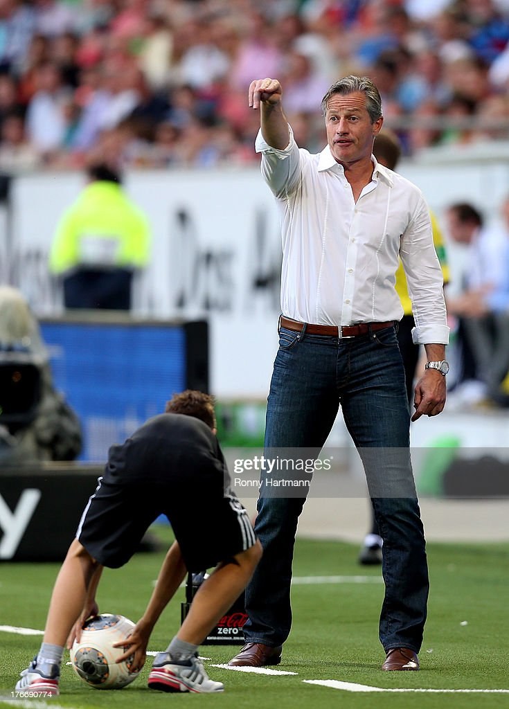 Head coach <a gi-track='captionPersonalityLinkClicked' href=/galleries/search?phrase=Jens+Keller&family=editorial&specificpeople=2382918 ng-click='$event.stopPropagation()'>Jens Keller</a> of Schalke gestures during the Bundesliga match between VfL Wolfsburg and FC Schalke 04 at Volkswagen Arena on August 17, 2013 in Wolfsburg, Germany.