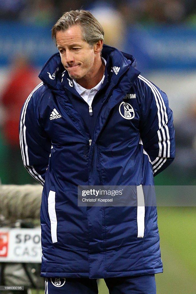 Head coach Jens Keller of Schalke looks dejected during the DFB cup round of sixteen match between FC Schalke 04 and FSV Mainz 05 at Veltins-Arena on December 18, 2012 in Gelsenkirchen, Germany.