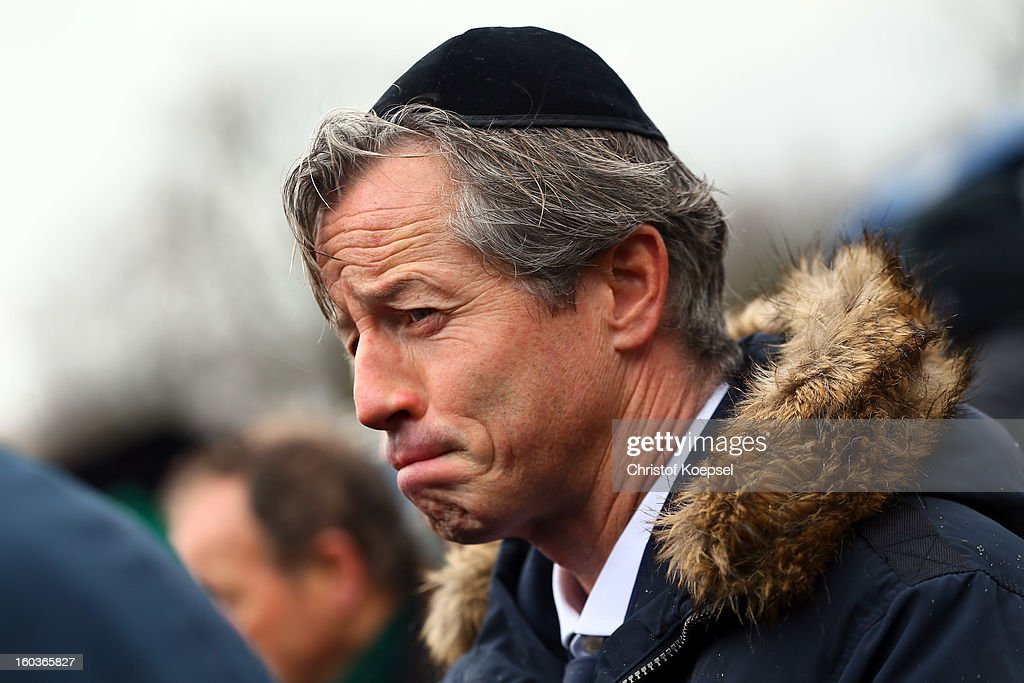 Head coach <a gi-track='captionPersonalityLinkClicked' href=/galleries/search?phrase=Jens+Keller&family=editorial&specificpeople=2382918 ng-click='$event.stopPropagation()'>Jens Keller</a> of Schalke looks thoughtful during the dedication of memorial board for Jewish Club Members at the 'Tausend-Freunde-Mauer' at Veltins-Arena on January 30, 2013 in Gelsenkirchen, Germany.