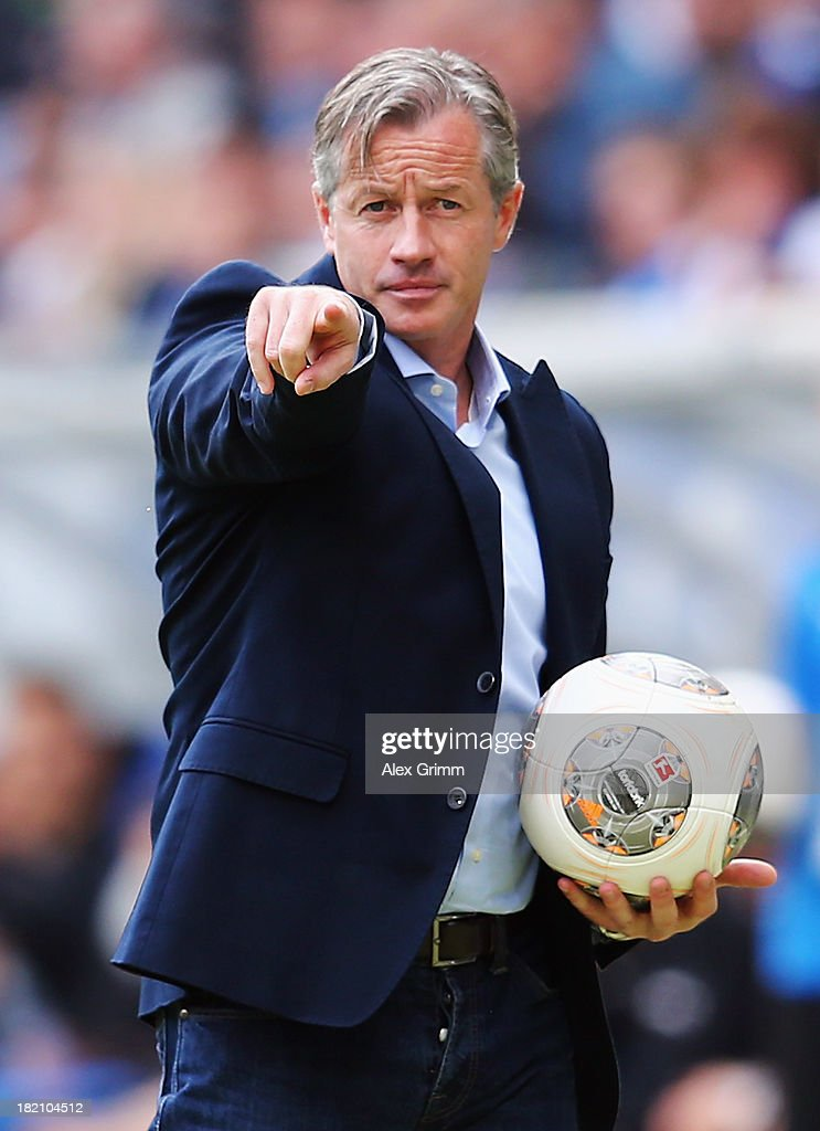Head coach <a gi-track='captionPersonalityLinkClicked' href=/galleries/search?phrase=Jens+Keller&family=editorial&specificpeople=2382918 ng-click='$event.stopPropagation()'>Jens Keller</a> of Schalke rasct during the Bundesliga match between 1899 Hoffenheim and FC Schalke 04 on September 28, 2013 in Sinsheim, Germany.
