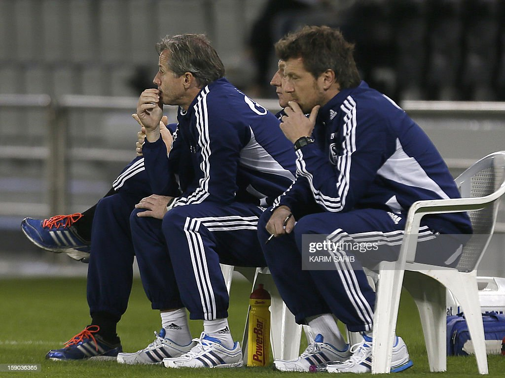 Head coach Jens Keller (C) of Schalke watches the friendly match between Al-Sadd Sports Club and FC Schalke 04 in Doha, on January 6, 2013. Schalke is in Qatar for a week-long training camp before the beginning of the new season of the German Bundesliga after the winter break.