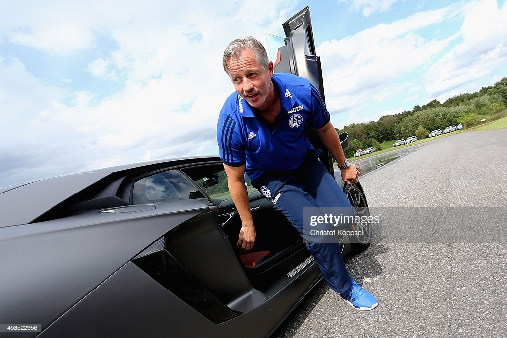 Head coach <a gi-track='captionPersonalityLinkClicked' href=/galleries/search?phrase=Jens+Keller&family=editorial&specificpeople=2382918 ng-click='$event.stopPropagation()'>Jens Keller</a> of Schalke wlaks out of a Lamborghini during a test drive at driving safety centre Rheinberg on August 12, 2014 in Rheinberg, Germany.