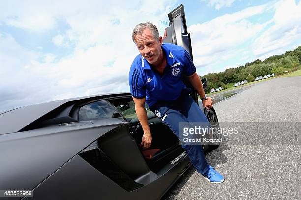 Head coach Jens Keller of Schalke wlaks out of a Lamborghini during a test drive at driving safety centre Rheinberg on August 12 2014 in Rheinberg...