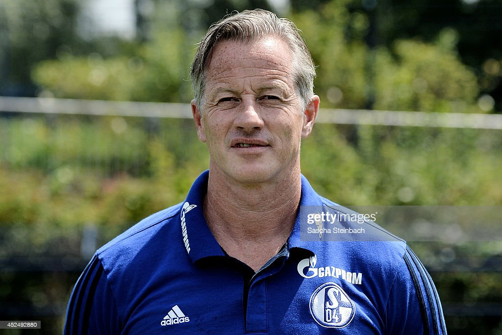 Head coach <a gi-track='captionPersonalityLinkClicked' href=/galleries/search?phrase=Jens+Keller&family=editorial&specificpeople=2382918 ng-click='$event.stopPropagation()'>Jens Keller</a> poses during FC Schalke 04 team presentation at Veltins-Arena on July 17, 2014 in Gelsenkirchen, Germany.